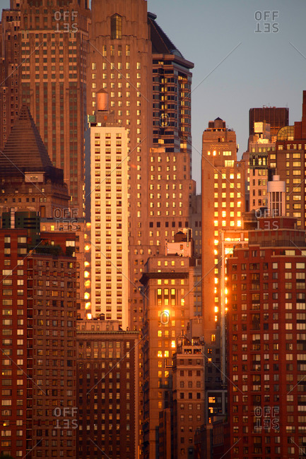 The setting sun reflecting in the windows of apartment and office buildings in Lower Manhattan, New York