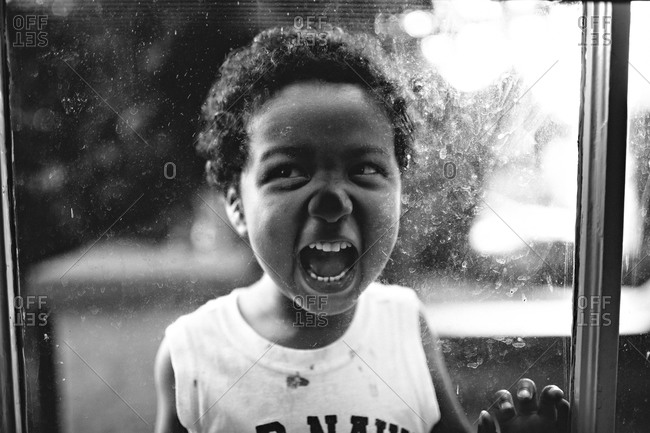 Boy presses nose against window