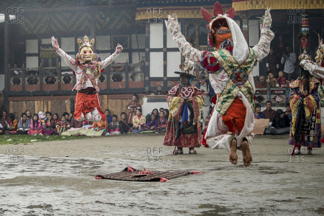 Bumthang, Bhutan, South Asia - September 15, 2013: Religious festival in Bhutan with dancers in the rain