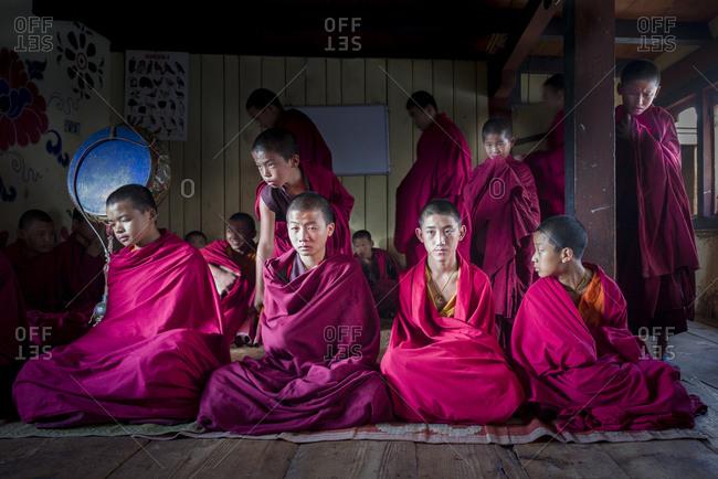 Bumthang, Bhutan, South Asia - September 19, 2013: Monks at Lobesa Monastery in Bhutan