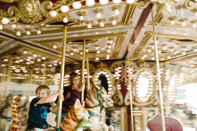 Children riding carousel