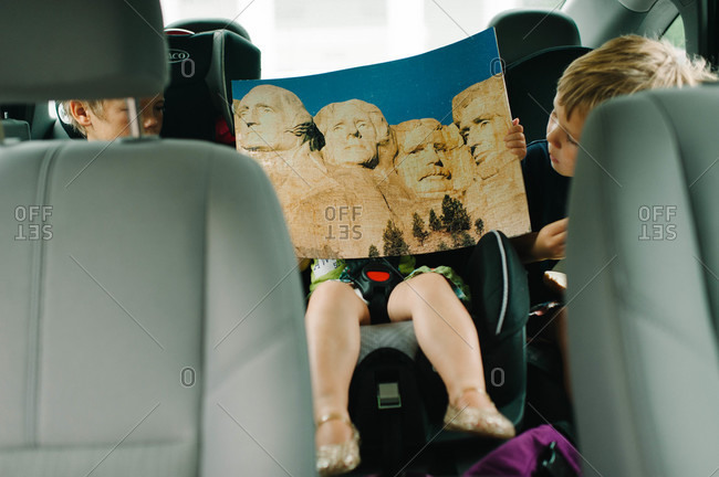 Children watching the brochure of Mount Rushmore National Memorial