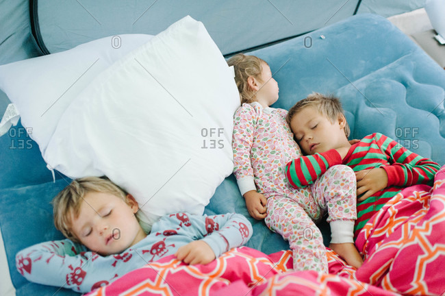 Children sleeping on inflatable mattress