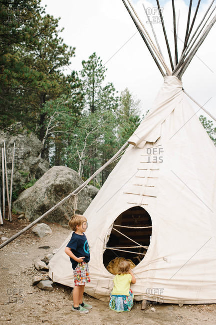 Children looking at a tepee