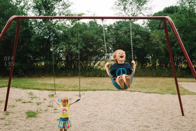 Children swinging on a playground