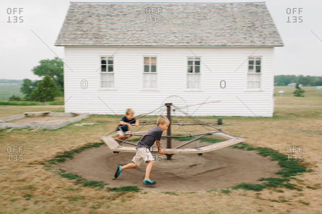 Boys playing with a swing at a house