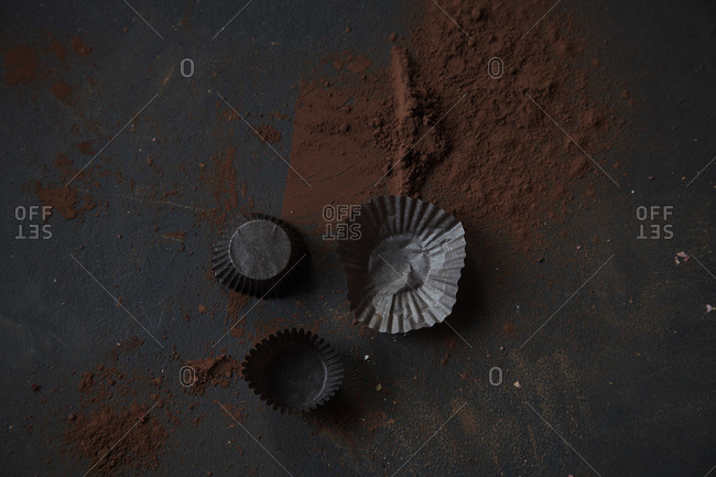 Studio shot of cocoa powder and baking cups
