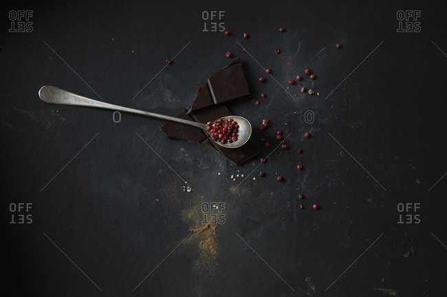 Studio shot of dark chocolate and pink peppercorns