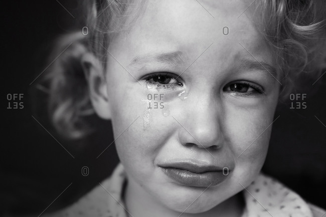 Headshot of a crying girl