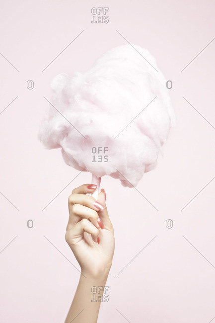 Woman holding a pink cotton candy