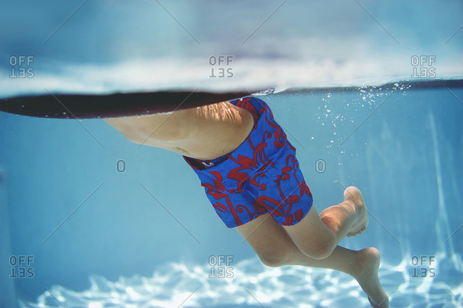 Young boy with a swimming float in a pool