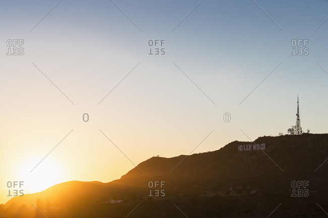 Los Angeles, California, USA - August 24, 2014: Hollywood Sign and antenna mast at sunset