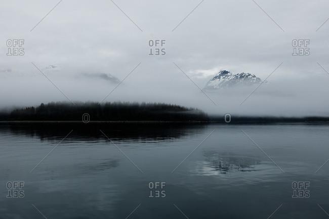 Mountains covered in fog in the Glacier Bay National Park, Alaska