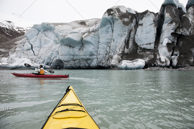 Glacier Bay National Park, USA - May 22, 2011: Person canoeing by a glacier in Glacier Bay National Park, Alaska