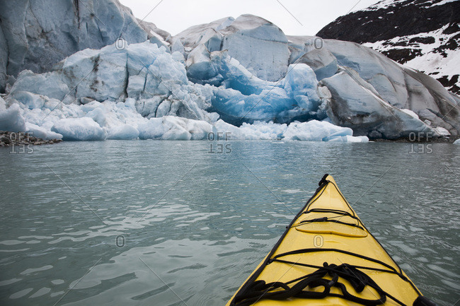 Canoeing by a glacier in Glacier Bay National Park, Alaska