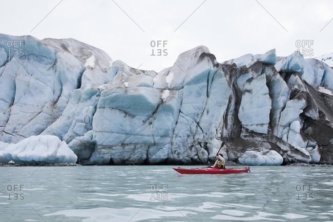 Glacier Bay National Park, USA - May 22, 2011: Person canoeing in Glacier Bay National Park, Alaska