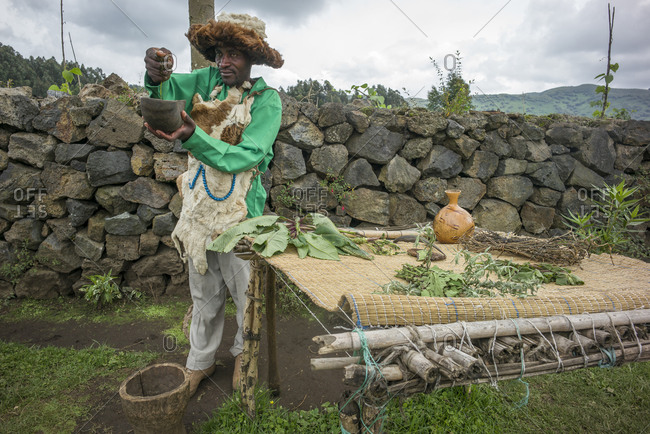 Virunga National Park, Rwanda, Africa - October 10, 2013: Man preparing a medicine from herbs