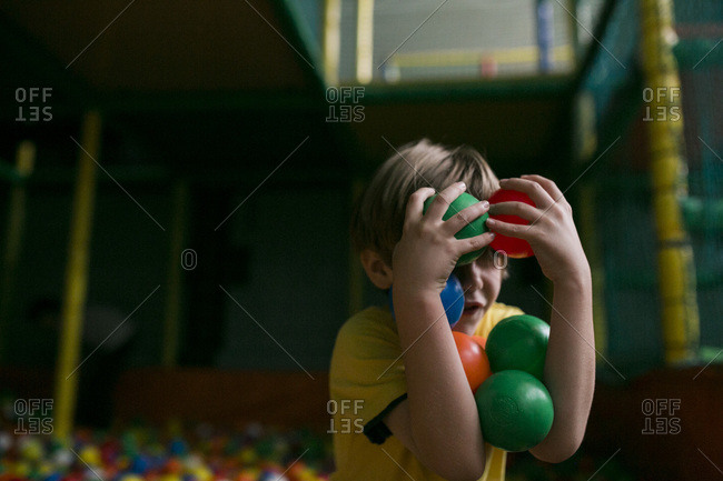 Boy in a ball pit