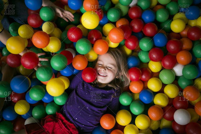 Smiling girl in ball pit