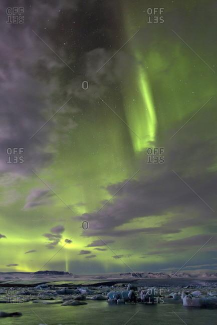The Aurora Borealis (Northern Lights) captured in the night sky over Jokulsarlon glacial lagoon on the edge of the Vatnajokull National Park, Iceland