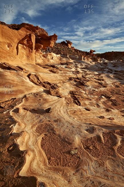Sandstone pattern under clouds