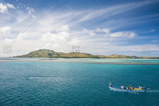 Yasawas, Fiji, South Pacific, Pacific - July 6, 2013: Little boat in the blue lagoon