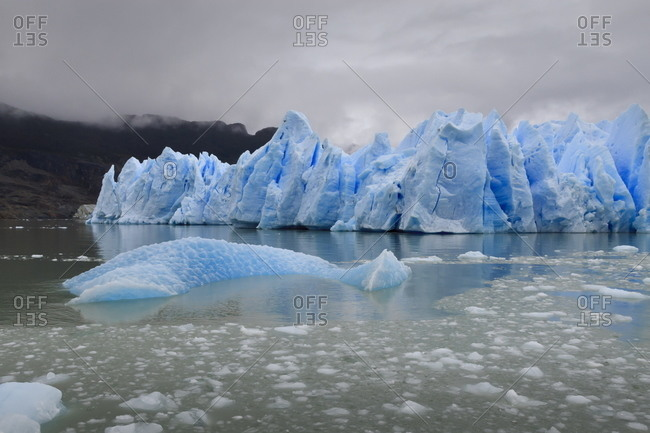 Lake-level view of blue ice at the glacier face and iceberg, Grey Glacier, Torres del Paine National Park, Patagonia, Chile