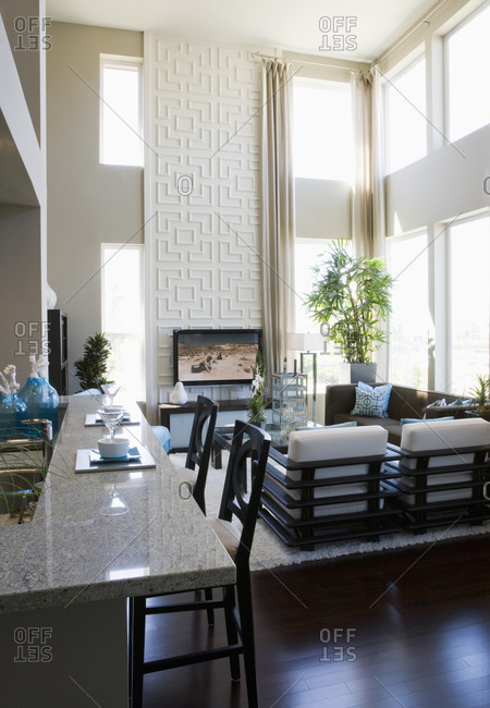Contemporary loft interior with breakfast bar and living room