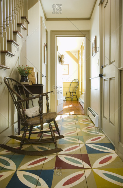 Hallway in colonial home with patterned wooden floor