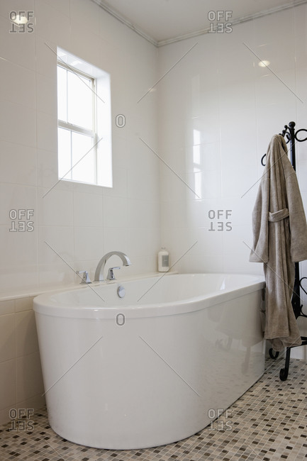 View of a bath with bathrobe on stand in the bathroom, Irvine, California, USA