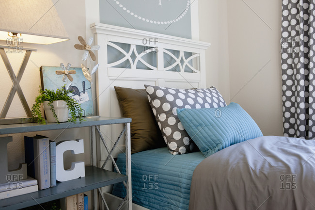 Bed and night table in middle class house
