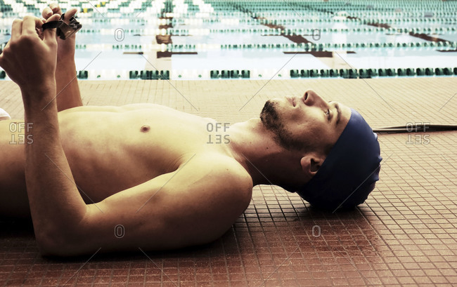 Man resting by a swimming pool