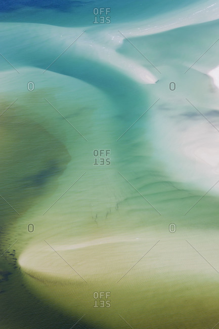 Patterns in undersea sand showing water currents and river outflows off Queensland, Australia