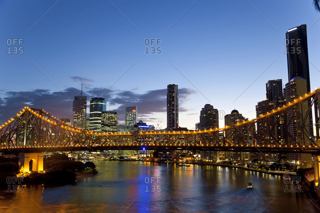 The Story Bridge over the Brisbane River illuminated at night before the skyline of the Central Business District, Brisbane, Queensland, Australia