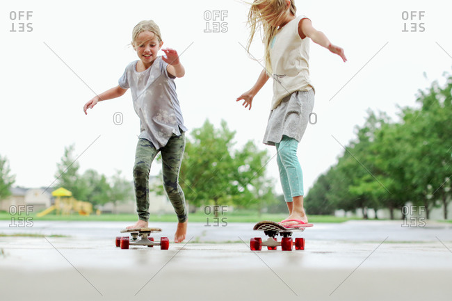 Girls riding skateboards on the street