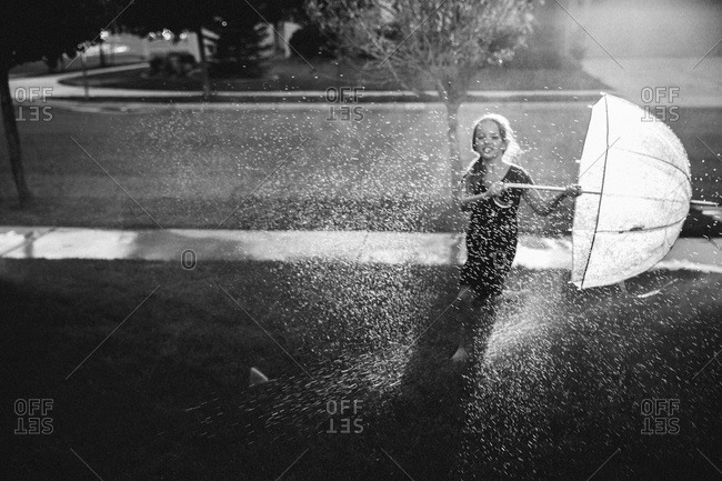 Girl playing with water sprinkler