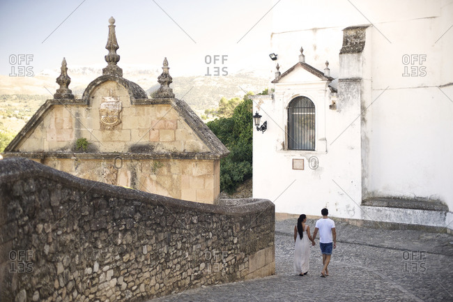 Couple walking along old town wall
