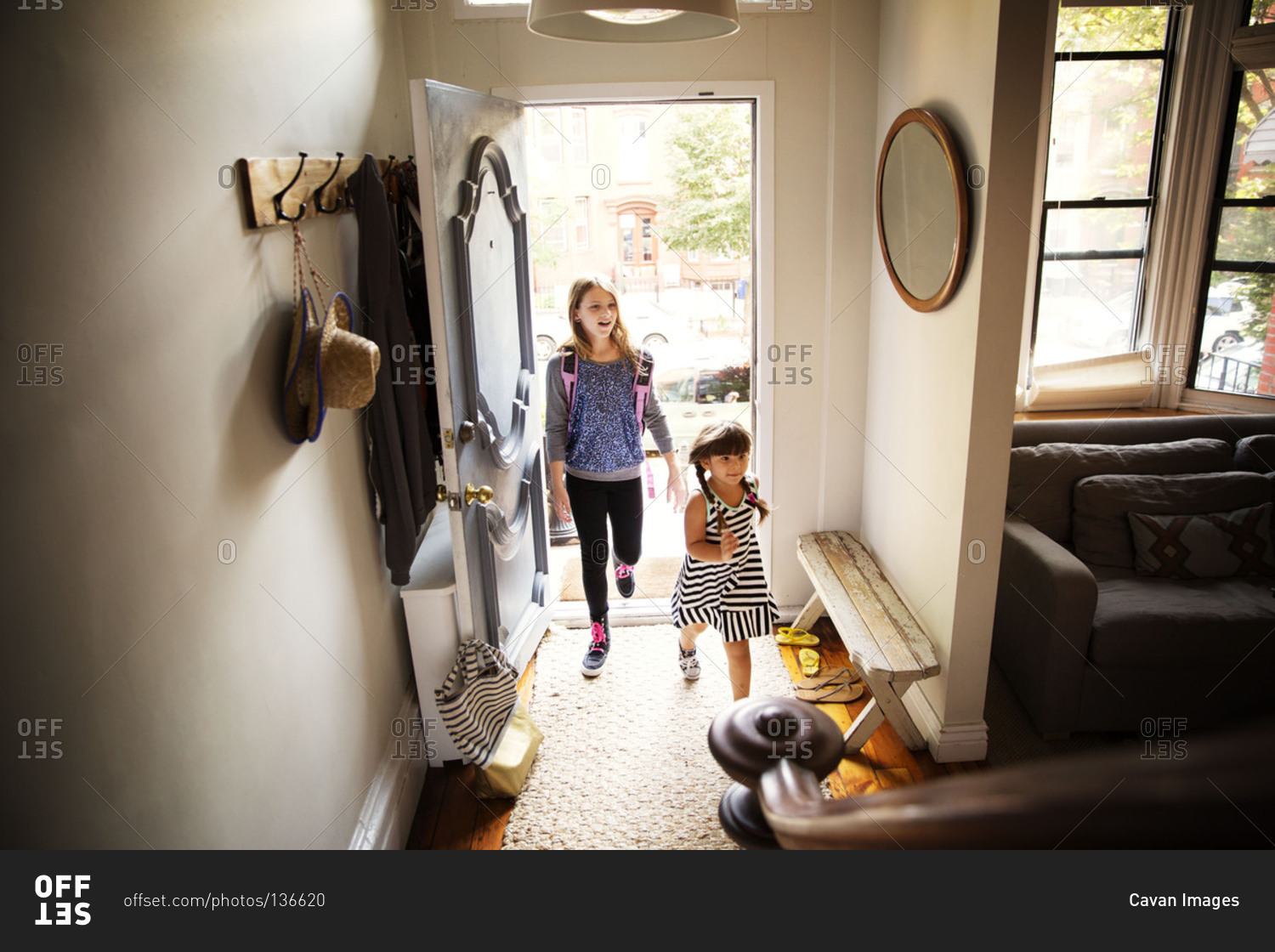 Children arriving home from school stock photo - OFFSET