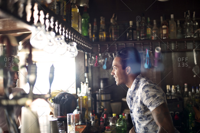 Bartender standing behind the counter in a pub