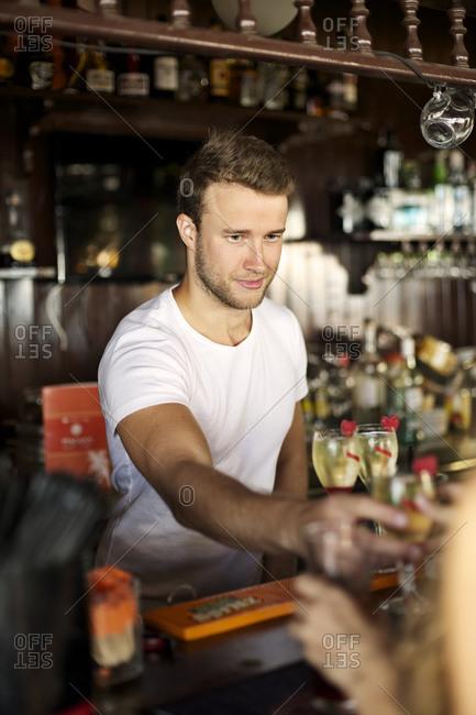 Bartender serving drinks in a bar