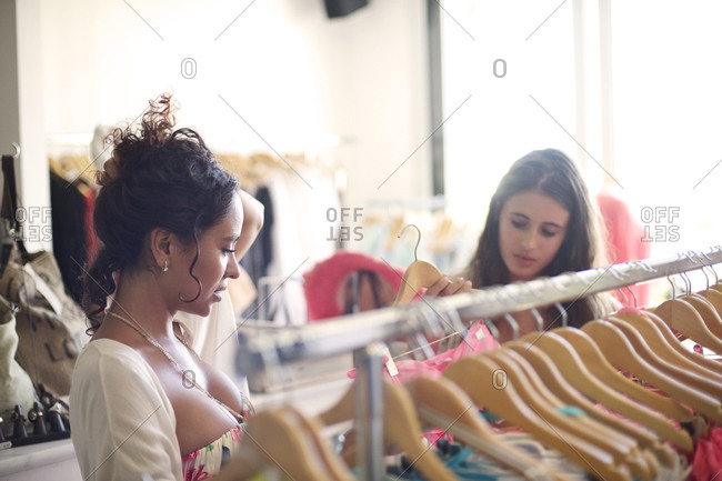 Young women choosing clothes in a boutique