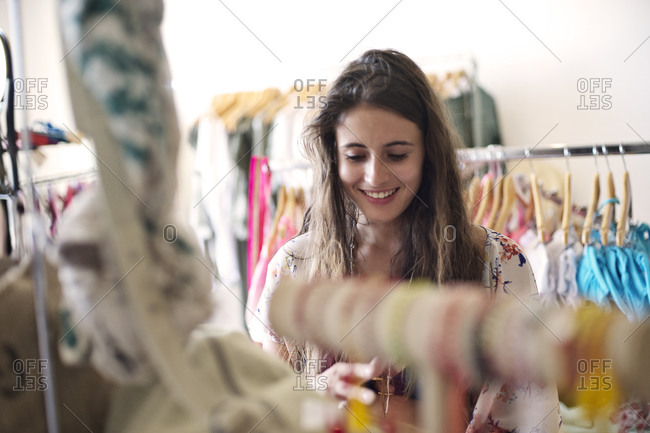 Smiling woman shopping in a clothing store