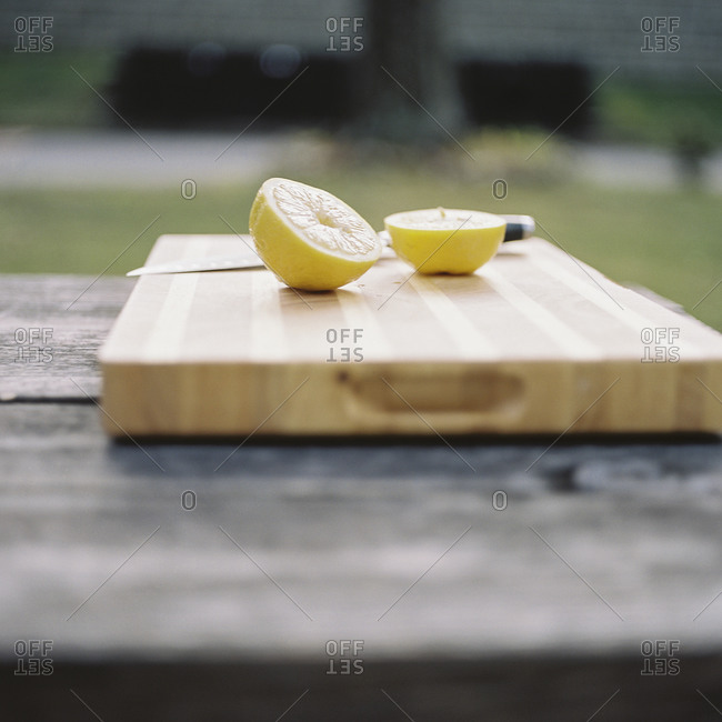 Halved lemon on a cutting board