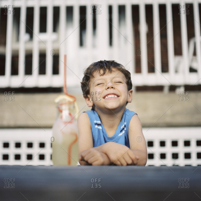 Portrait of a smiling boy with lemonade