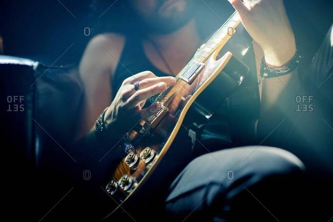Rock musician practicing electric guitar