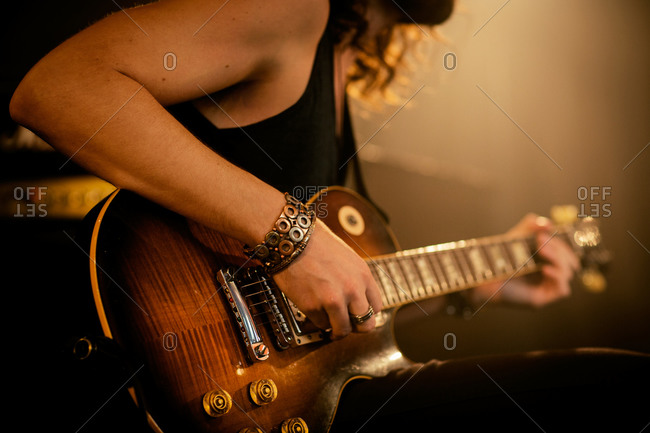 New York, NY, USA - August 7, 2014: Rock musician playing on electric guitar