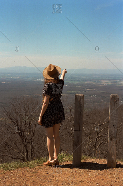 Woman pointing into the distance