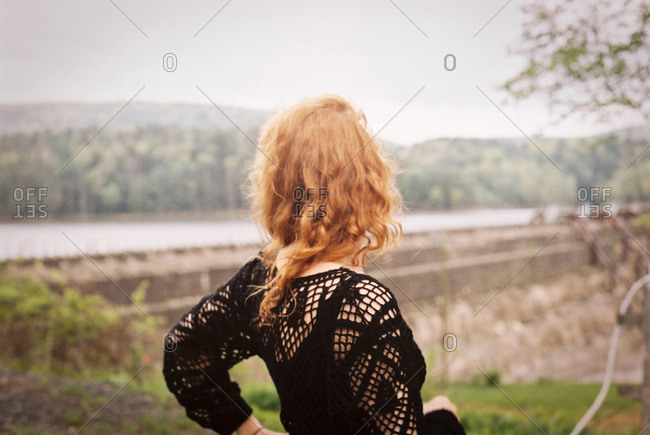 Back view of a red headed woman