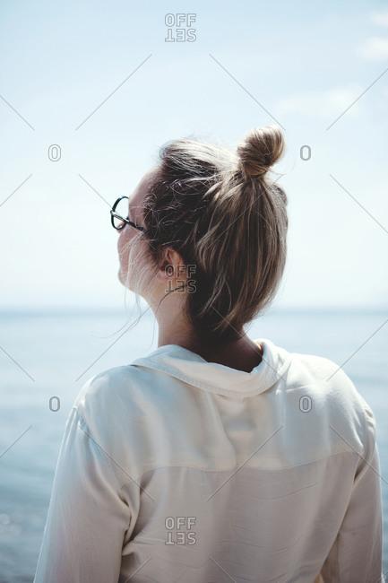 Back view of woman enjoying the sunshine