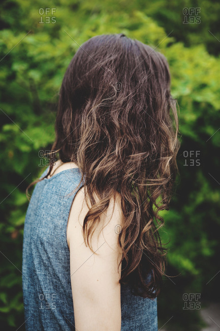 Curly hair of a brunette woman